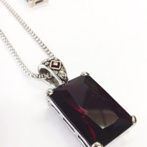 Pendant Dark Ruby colored Stone